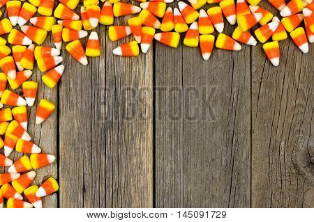 Halloween Candy Corn Top Corner Border Against A Rustic Wood Background