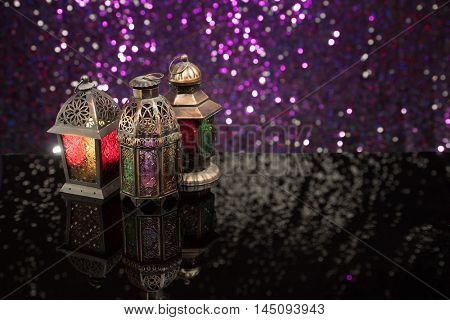 Eid and Ramadan Theme images with lanterns and nuts against a purple glitter background
