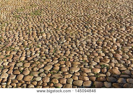 Cobbled ancient stone road background Avignon Provence