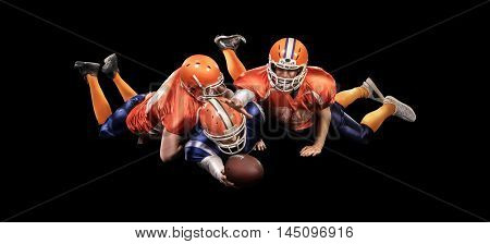 Professional american football players in action with ball on black background