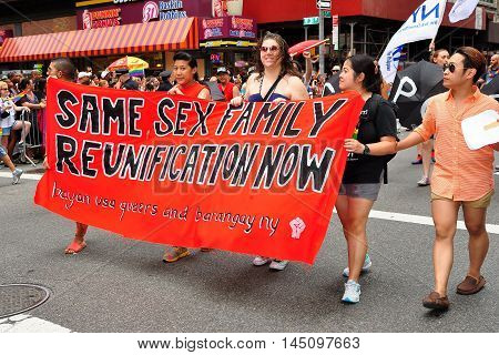 New York City - June 29 2013: Same Sex Family Reunification group marching with their banner in the 2013 Gay Pride Parade on Fifth Avenue