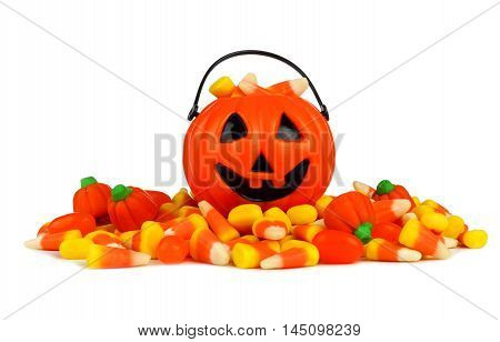 Small Halloween Jack O Lantern Pail With A Pile Of Candy Over A White Background