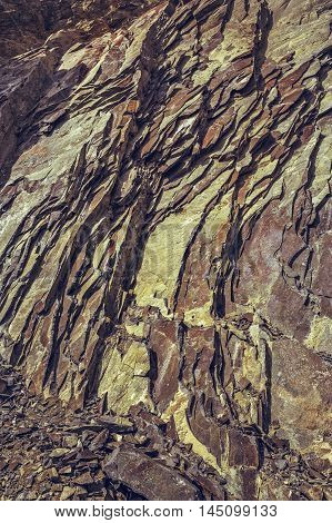 Layered Basalt Rock Cliff