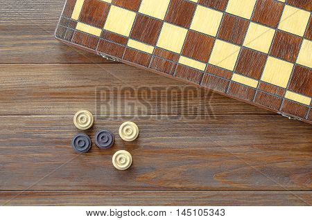 Table game checkers draughts on wooden background