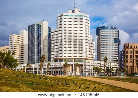 TEL AVIV, ISRAEL - JANUARY 1, 2016: Gorgeous Tel Aviv promenade in stormy weather. Strong winds and bright sunshine - perfect weather for a winter walk