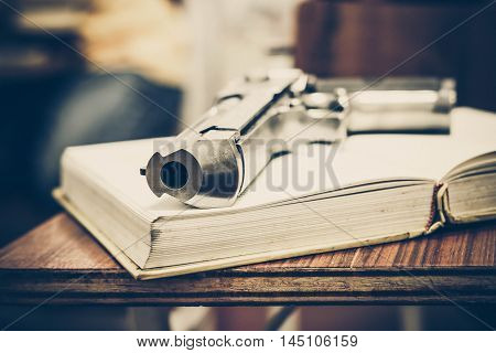 A gun on a textbook / gun allowed in some US university concept