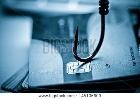 credit card phishing attack / credit card with a hook
