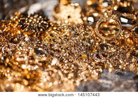 Luxury precious background of close up of golden jewelry