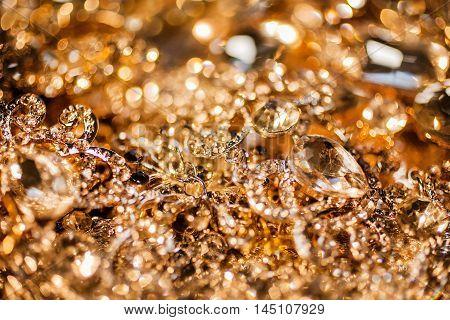 Luxury shiny precious background of golden jewelry