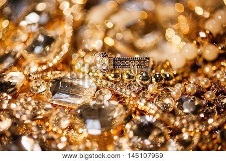Luxury beautiful precious background of golden jewelry