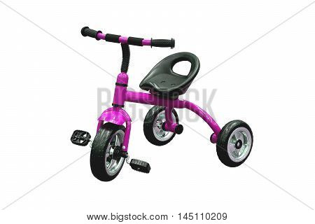 Tricycle for kids in purple color isolated