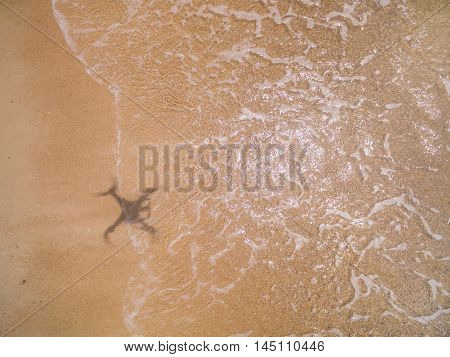 Quadcopter shadow on the sand in Thailand