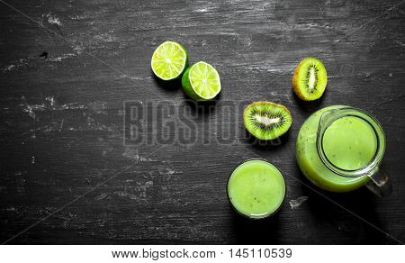 Fitness food. Fresh juice of kiwi and lime in the pitcher.