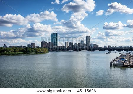 Boston Massachusetts skyline on the water during summer time