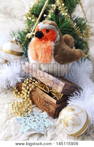 New Year composition: bullfinch and Christmas-tree decorations