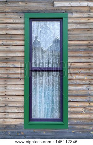 Vintage window on side of country building