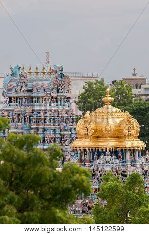 Madurai India - October 19 2013: Closeup of the golden dome of the Meenakshi shrine on the temple grounds. Other Vimanam in photo too.