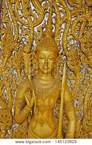Traditional carved wooden door at Wat Tha Sung temple in Uthai Thani, Thailand.