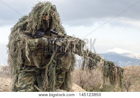 Ghillie suit sniper scope and rifle camouflage