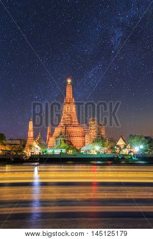 Wat Arun Buddhist religious places under milky way stars and space dust in the night sky Bangkok Thailand