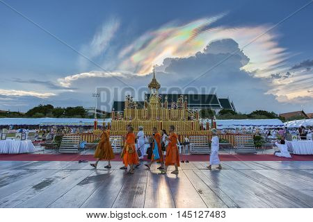 BANGKOK THAILAND - JUNE 6: ceremony cremation of Buddha (simulation) with the monk and people activities a lot. This is a natural phenomenon. Cloud beautiful rainbow in the sky as a backdrop.