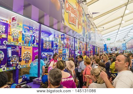 Melbourne, Australia - September 25, 2015: People queueing up to buy showbags in the Showbag Pavilion in the 2015 Royal Melbourne Show.