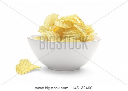 Potato chips in the faience white bowl isolated