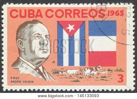 MOSCOW RUSSIA - CIRCA AUGUST 2016: a stamp printed in CUBA shows a portrait of Professor Andre Voisin the series