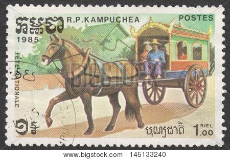MOSCOW RUSSIA - CIRCA AUGUST 2016: a stamp printed in CAMBODIA shows a horse-drawn cart the series