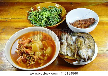 deep fried snake head fish eat couple with mixed vegetable Thai spicy and sour soup