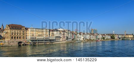 Basel, Switzerland - 27 August, 2016: buildings along the Rhine river. Basel is a city on the Rhine river in northwestern Switzerland, situated where the Swiss German and French borders meet.