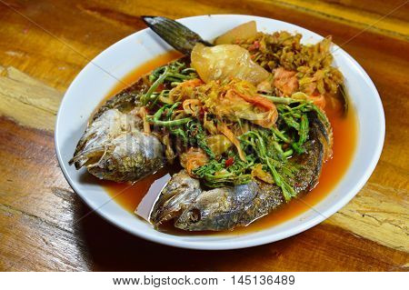 deep fried striped snake head fish in mixed hot and sour soup on dish