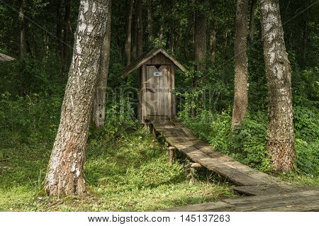 Wooden Wc In The Forest