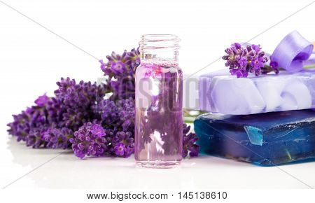 handmade lavender oil and soap with fresh lavender on white background