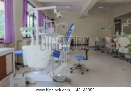patient chair Dentistry In Clinic Dentist. Professional Dentist tools in the dental office. Dental Hygiene and Health . Blur blurred image.