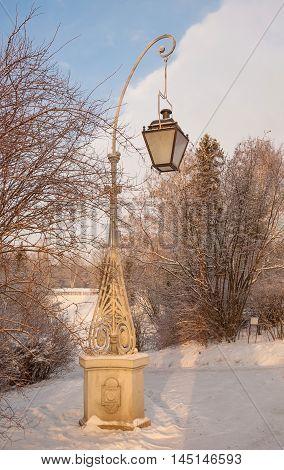 Ancient lantern in the winter Pavlovsk park
