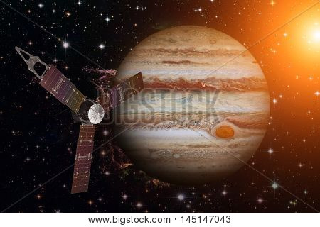 Juno Spacecraft And Jupiter. Elements Of This Image Furnished By Nasa.