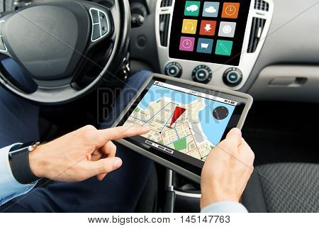 transport, business trip, technology, navigation and people concept - close up of male hands holding tablet pc computer with gps navigator map on screen in car