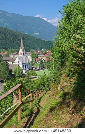 Alpine village of Sachsenburg in the Drau river valley, Carinthia, Austria