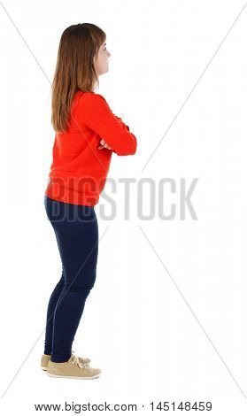 back view of standing young beautiful woman. girl in the red sweater is left side with his arms crossed.
