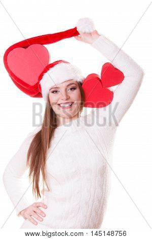 Helping giving and love concept. Happy smiling woman in santa hat holding red heart box present. Christmas winter time.