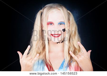 Cute Child Girl with Halloween Makeup having Fun