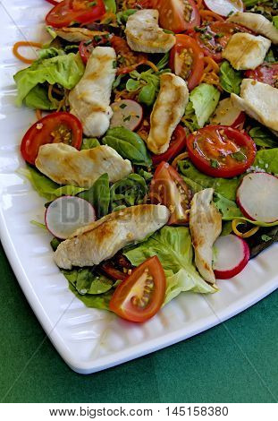 mixed italian salad with roasted chicken strips