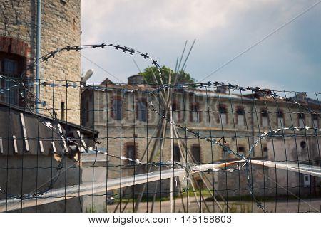 TALLINN, ESTONIA - JUNE 30, 2013: Barbed wire of prison Patarei museum in Tallinn Estonia