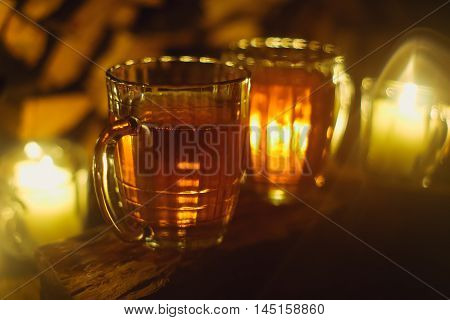 Beer on the wood with candles. Tinted. Selective focus