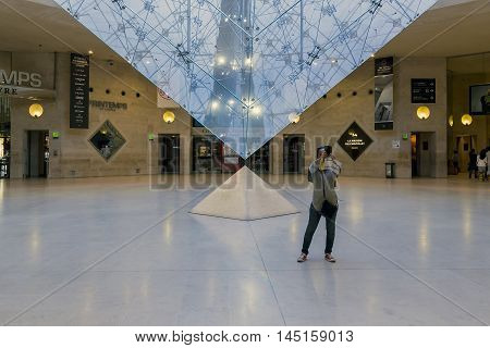PARIS, FRANCE - MAY 13, 2015: The inverted pyramid under the Carousel area is included in the architectural composition of the five pyramids