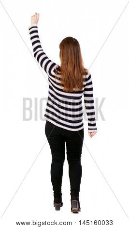 Back view of business woman. Raised his fist up in victory sign. Raised his fist up in victory sign. Girl in a striped jacket joyfully raised her hand up.
