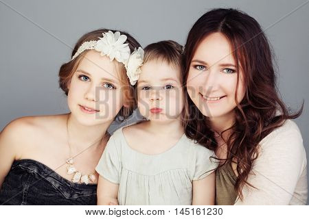 Females Family. Happy Mother and Daughters (3 and 10 years old)