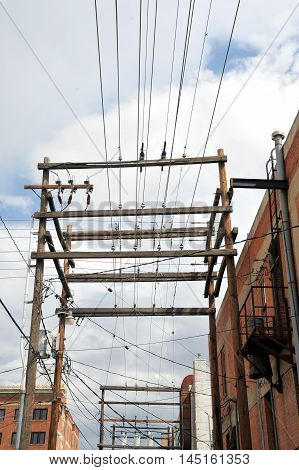 Electrical power lines standing tall high in the sky.
