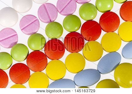 Background of colorful different kind medical pills.